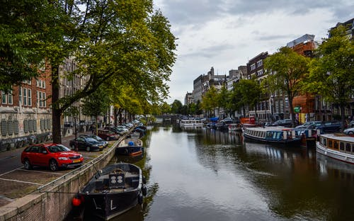City historical district with moored boats on canal