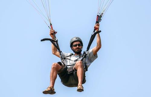 Man Riding a Paraglide