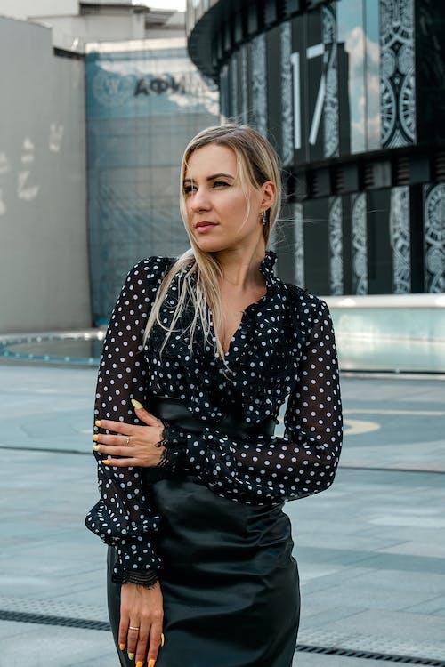 Elegant woman standing outside modern building