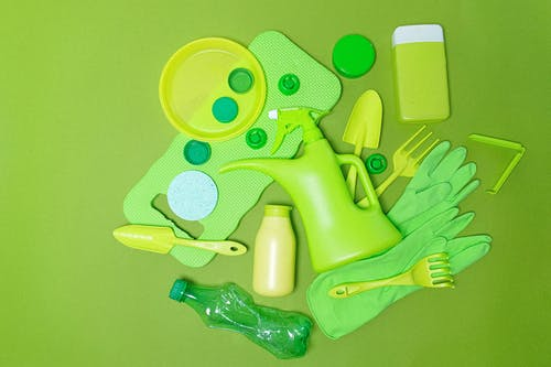 Plastic containers and items on green surface