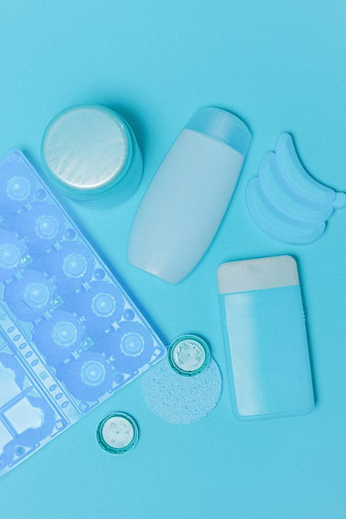 Collection of plastic containers and household supplies