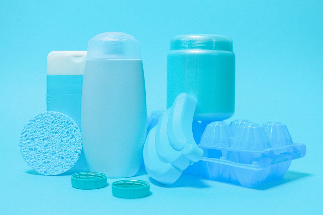 Different plastic bottles and household supplies