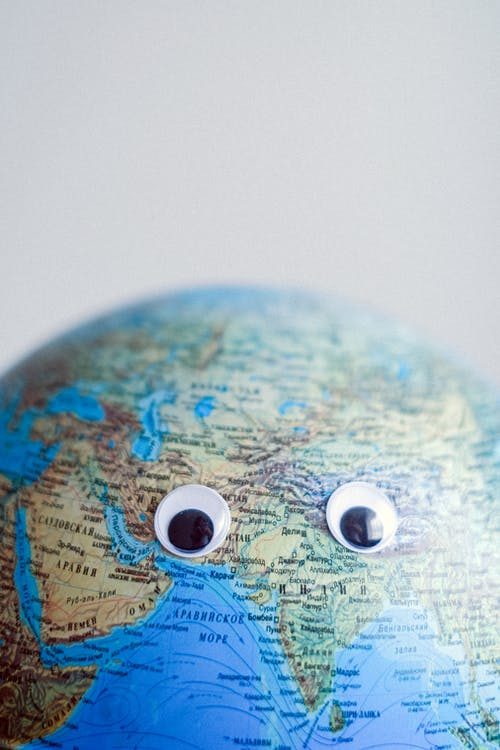 Model of globe with googly eyes representing Earth as character with need of protection
