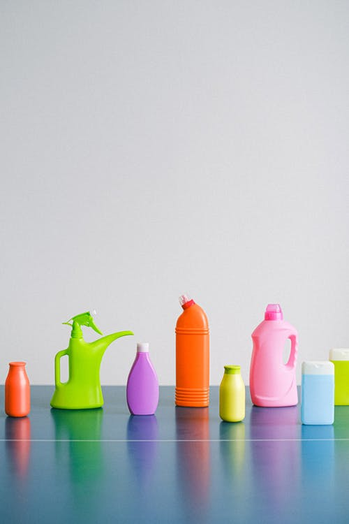 Reusable containers for cleaning products on table