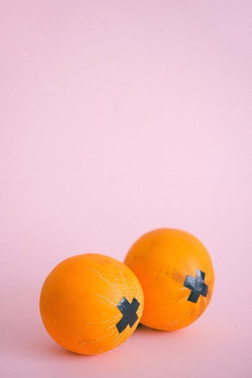 Ripe oranges with black tape crosses