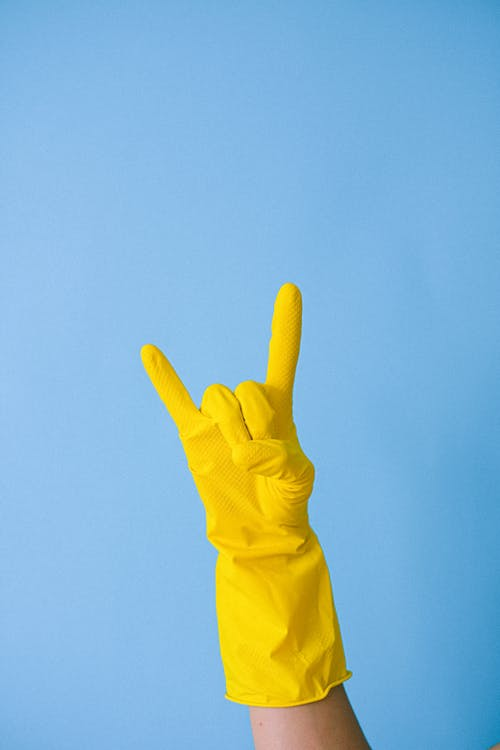 Crop unrecognizable person showing horn gesture