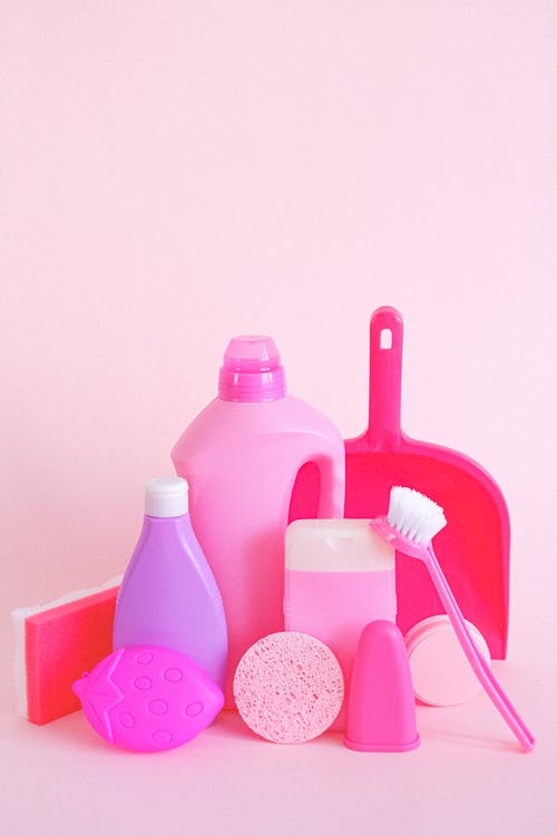 Plastic containers with cleaning supplies for household