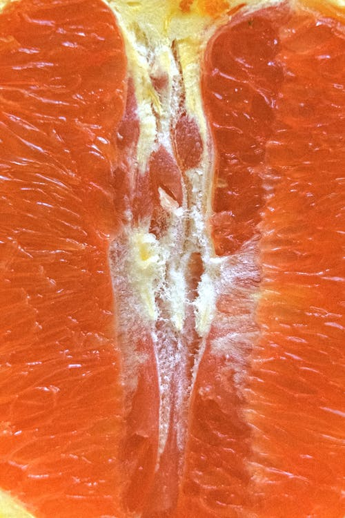 Closeup of fresh cut tropical fruit with orange pulp for vitamin diet and healthy lifestyle