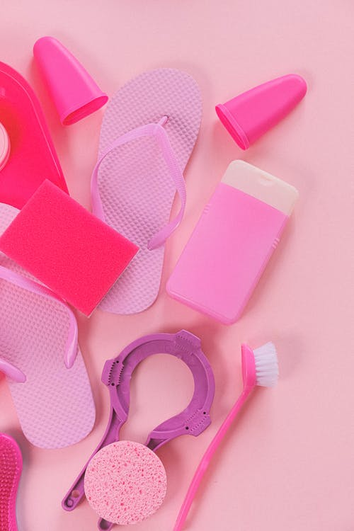 Composition of cleansing tools on pink background