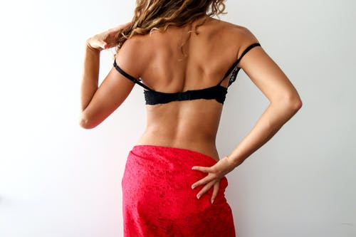 Woman in Black Brassiere and Red Skirt