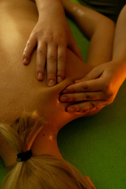 Young female lying on massage table during massage