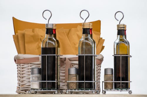 Clear Glass Bottles on Stainless Steel Rack