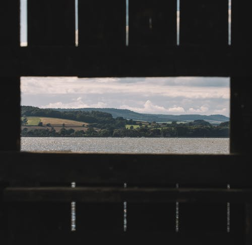Wooden fence with view of river and mountains