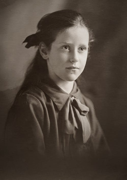 Classic Photo Of Young Girl in Black Button Up Shirt