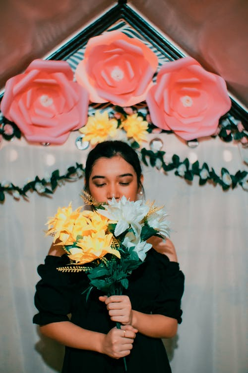 Woman Holding a Bouquet of Flowers