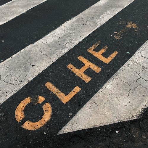 Black and Yellow Pedestrian Lane