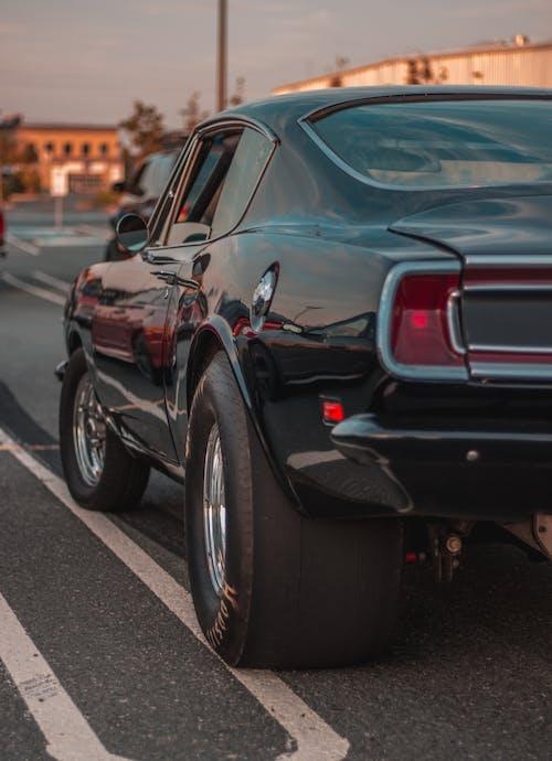 Stylish retro car on parking lot at sundown