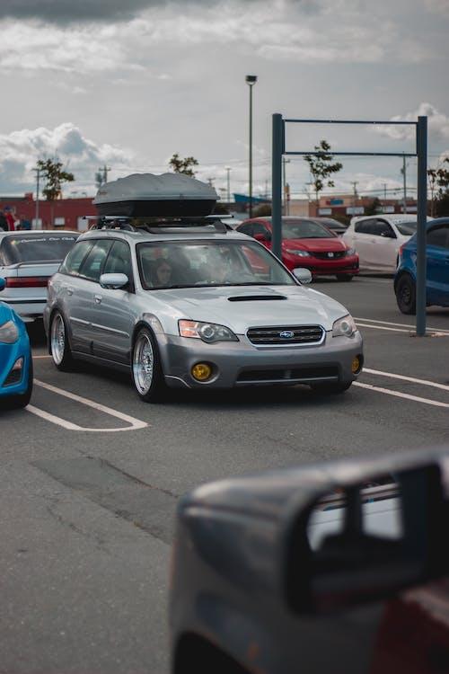 Fotos de stock gratuitas de aparcado, aparcamiento, aparcando