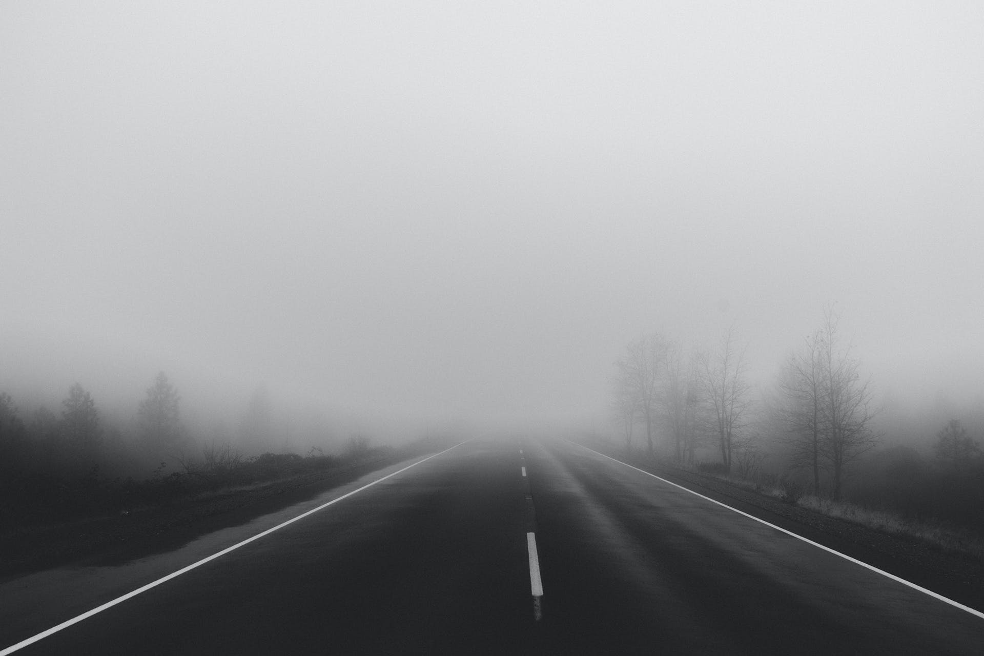 Gray Asphalt Road during Fog
