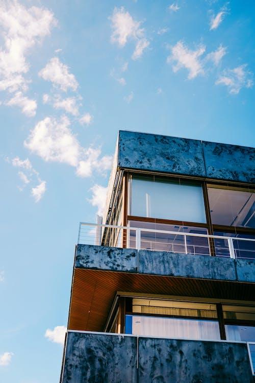 Modern residential building corner under blue sky