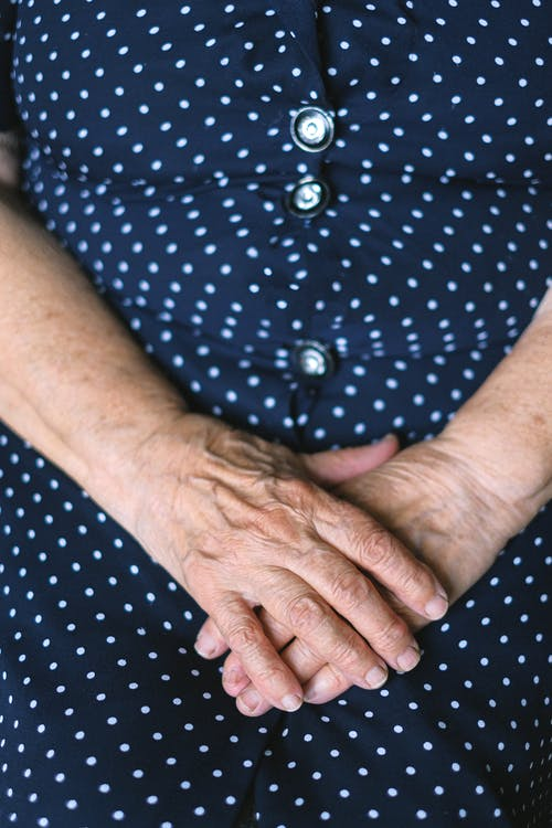 Crop senior woman with folded hands