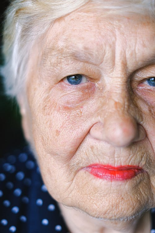 Crop elderly woman with gray hair