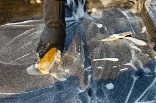 Kostenloses Stock Foto zu bürsten, hand, latex handschuhe