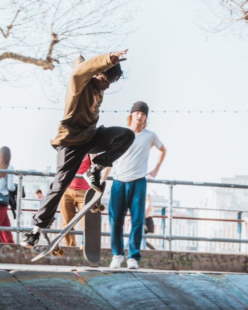 A Young Man Performing Skateboard Tricks