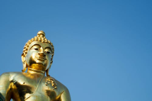 Golden Statue of a Buddha in Low Angle Shot