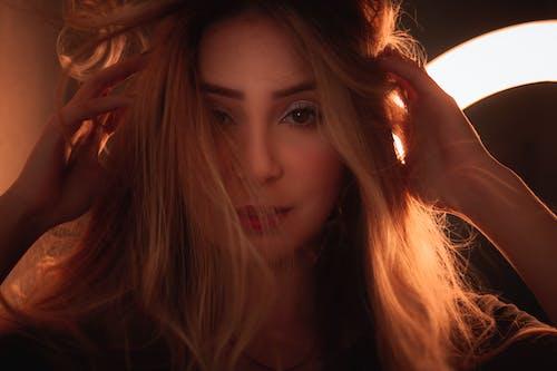 Free stock photo of against light, beautiful girl, blonde, light ring