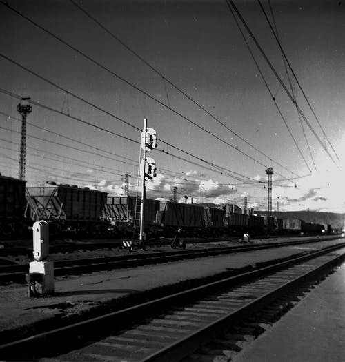 Railroad platform in industrial district on sunny day