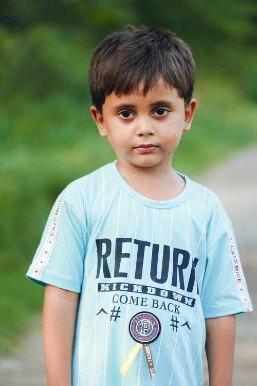 Photo of a Boy in Blue Crew Neck Shirt