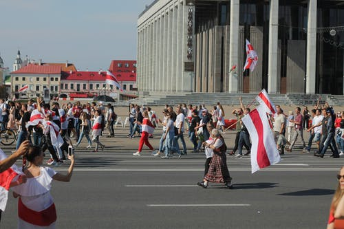 People in a Street With Flags