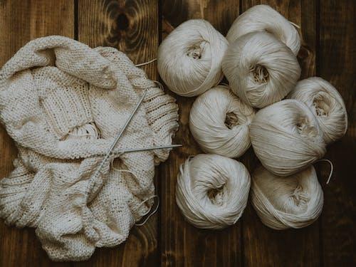 Handmade Sweater and White Yarn Rolls