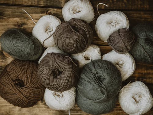 Brown Gray and White Yarn Rolls