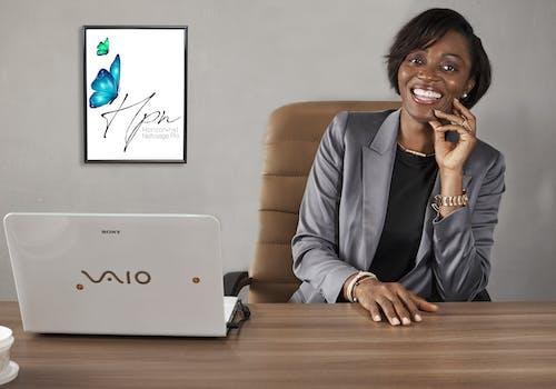 Woman in Gray Blazer Sitting on Chair