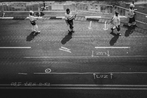 Grayscale Photo of 2 Men Playing Soccer
