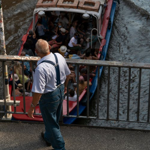 Man Looking at a Crowded Boat