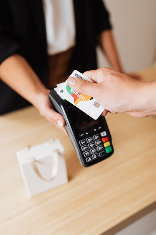 Person Paying Cashless Using Credit Card