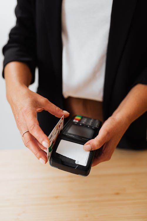 A Person Holding Black Payment Terminal