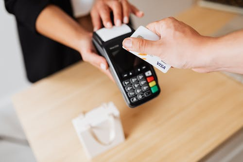 A Person Paying Cashless Using Credit Card