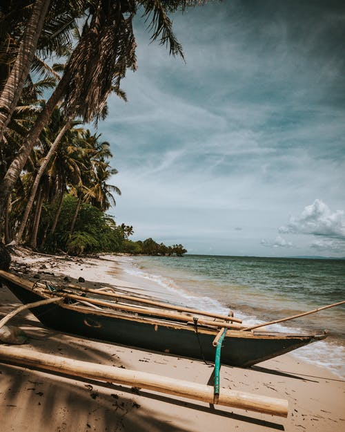 Brown Wooden Boat on Beach