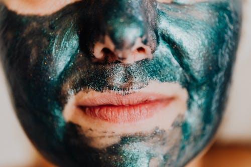 A Person Face on Green Facial Mask