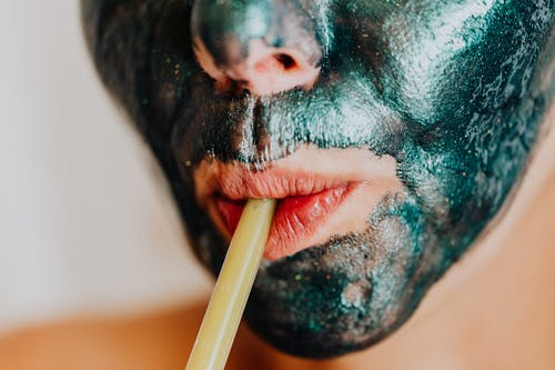 Man With Black and Green Face Paint