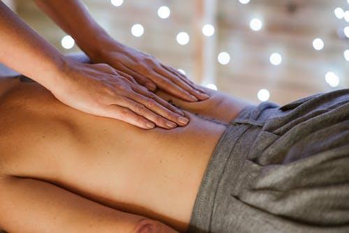 Crop master massaging topless client