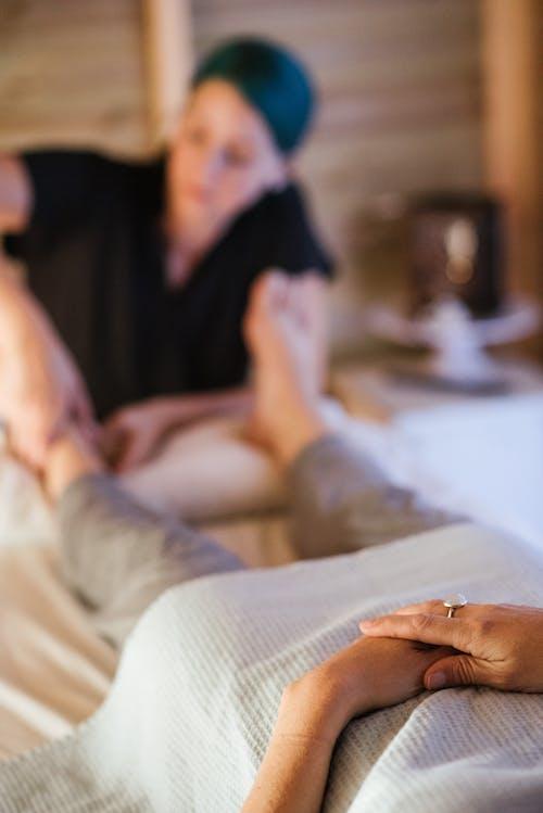 Unrecognizable woman getting feet massage