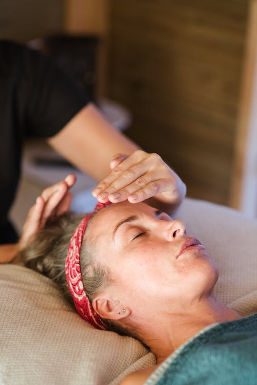 Relaxed woman getting alternative massage