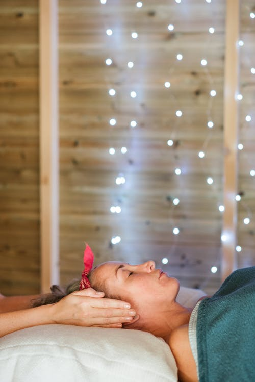 Woman lying on couch at spa salon