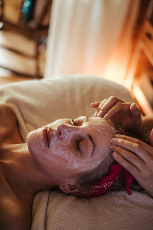 Woman enjoying massage while mask on face