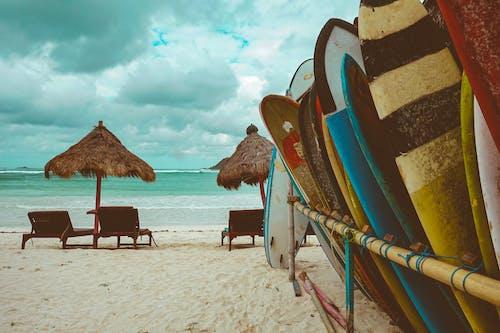 Brown Wooden Beach Lounge Chair on Beach
